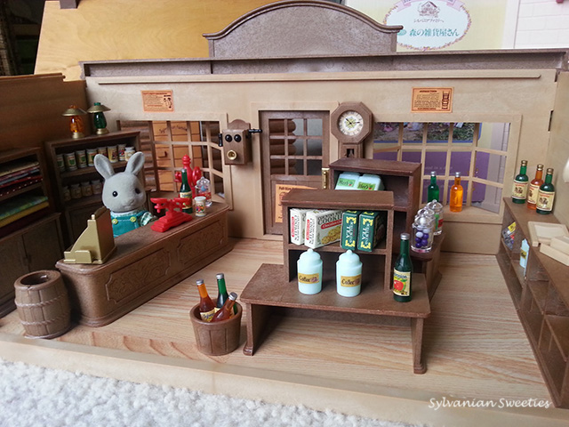 JP Grocery Store. Mr. Rocky Babblebrook loves serving the people of Sylvanian Village.